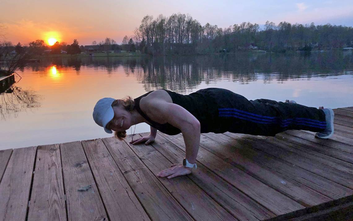 Michelle Mosberger performs push-ups at her home in Hillsborough. Photo courtesy of Michelle Mosberger.