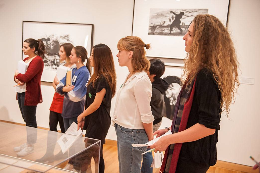 Duke students in the Museum Theory and Practice class listen as Nasher Museum Director Sarah Schroth talks about prints by Kara Walker that are part of the museum's collection. Photo by J Caldwell