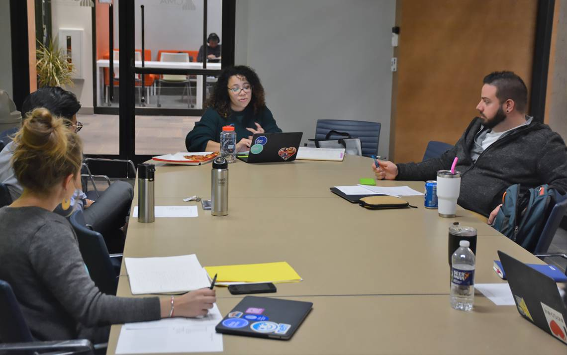 Francesqa Santos, center, a new employee with Duke Student Affairs' Student Involvement team, speaks during a staff meeting. Photo by Jonathan Black.