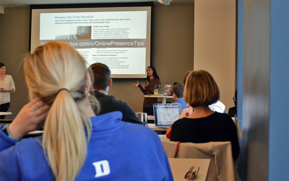 """About two dozen Duke community members gather for OIT's Learn IT @ Lunch seminar, """"Managing Your Online Presence."""