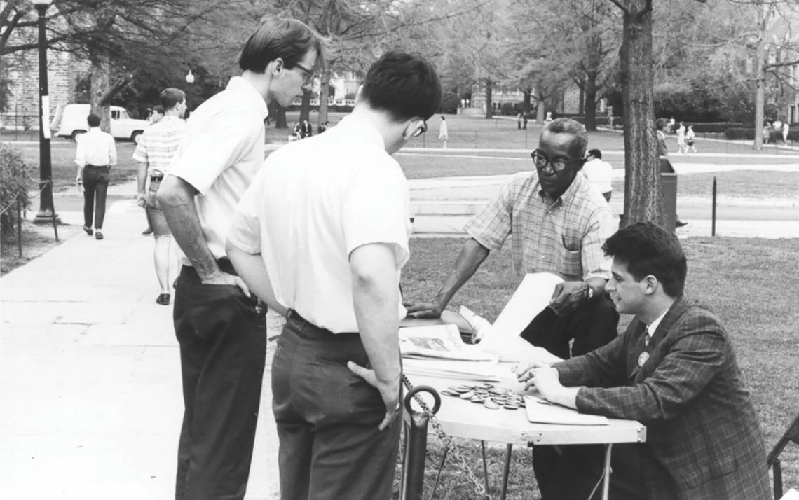 Oliver Harvey distributes literature in April 1967 on campus. Photo courtesy of North Carolina Collection, Durham County Library.