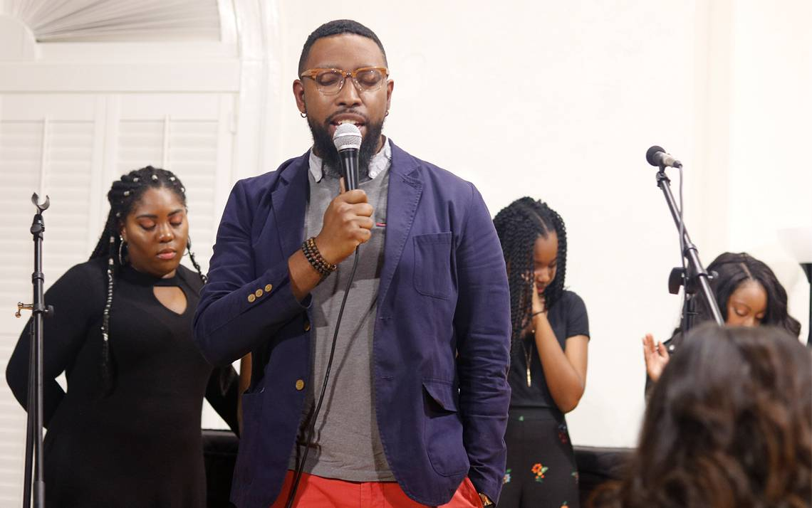 Joshua Lazard performs with the Duke student gospel choir United in Praise, which is he is the adviser for. Photo by Corey Pilson.