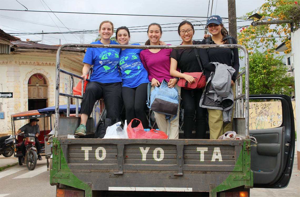 Members of the Bass Connections Global Health team load supplies into a pick-up truck for a trip to a nearby village in northeast that borders the Amazon jungle.