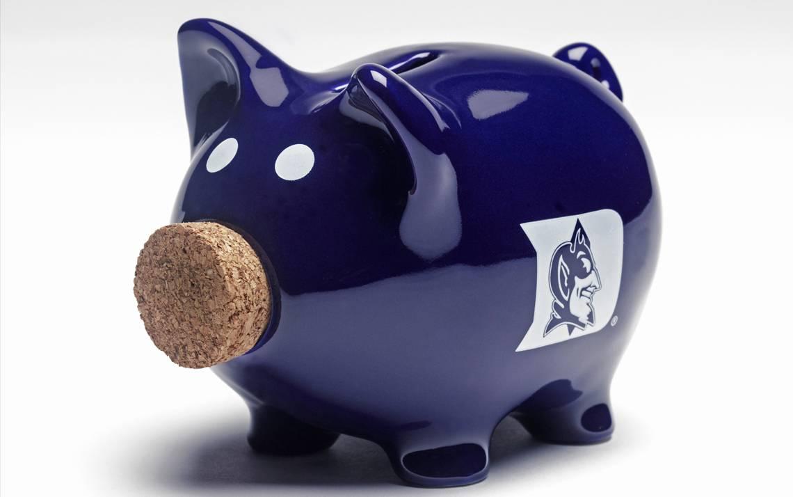 Blue piggy bank with a Duke logo.