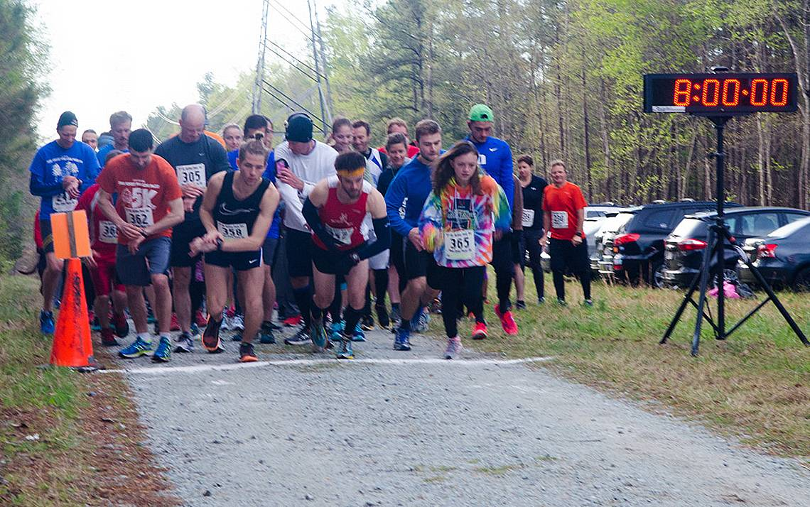 Runners leave the starting line at the Pine Cone Pacer.