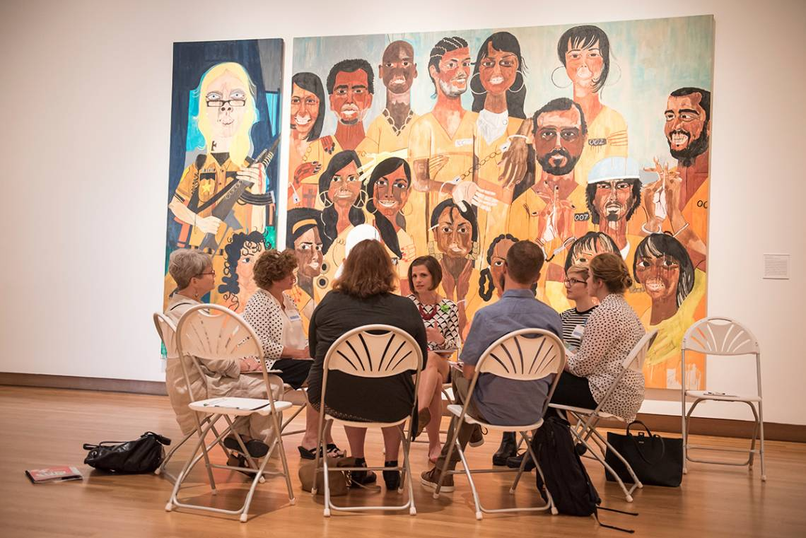 Jessica Ruhle, center, guides a conversation on art at the Nasher Museum as part of the Reflections program. Photo by J Caldwell