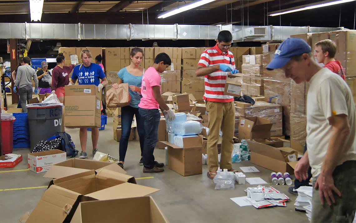 Volunteers sort surplus medical supplies for REMEDY at Duke.