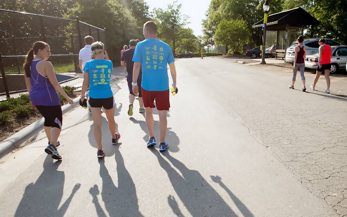 Duke employees walk together during a Run/Walk Club meetup.