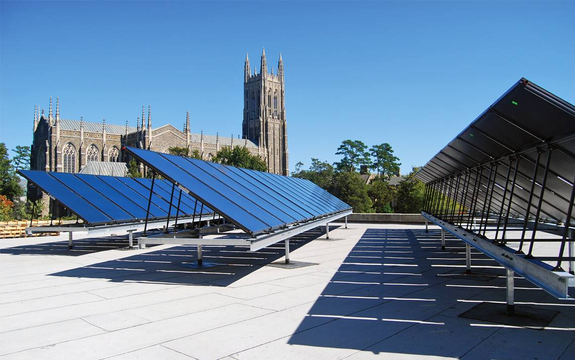 These solar panels on the roof of the Bryan Center are just one way Duke is working to lower its carbon footprint.