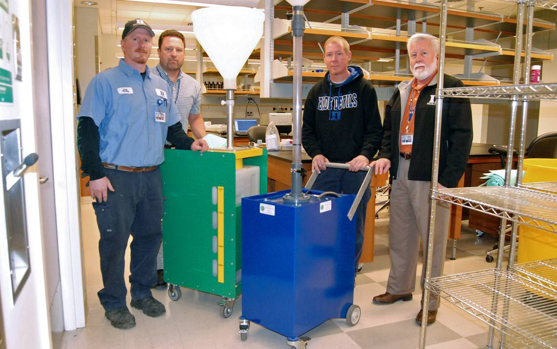 From left: David Wilson, Steve Williams, Bryan Curtis and Mike Snyder stand with Duke's Safety Shower Test Carts.
