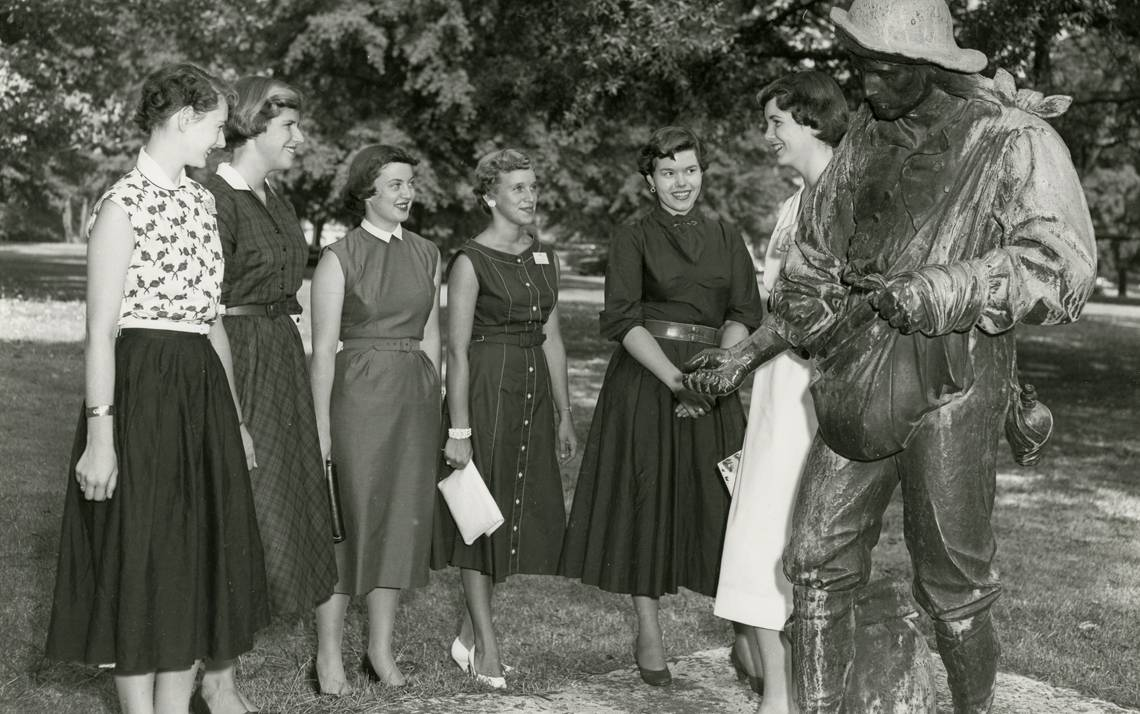 Duke students gather around The Sower on East Campus in 1954.