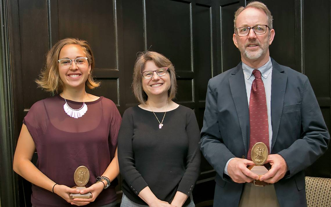 Sullivan Award winners Lauren Harper, left, and Rick Hoyle, right, received their awards from Provost Sally Kornbluth, center, on Friday.