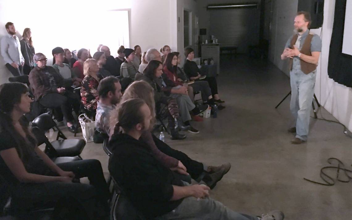 Filmmaker David Gatten speaks at a Sunday Salon last fall. Photo courtesy of Jason Sudak