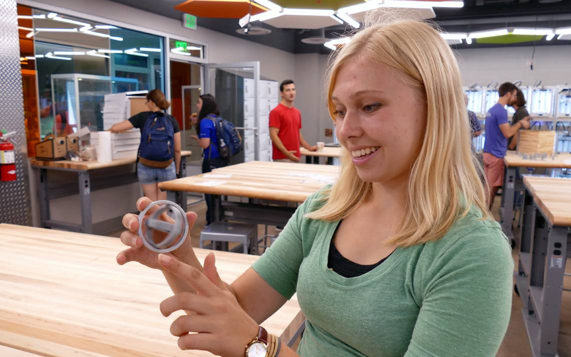 Student Kris Elbert shows off a 3D print creation at the Technology Engagement Center.