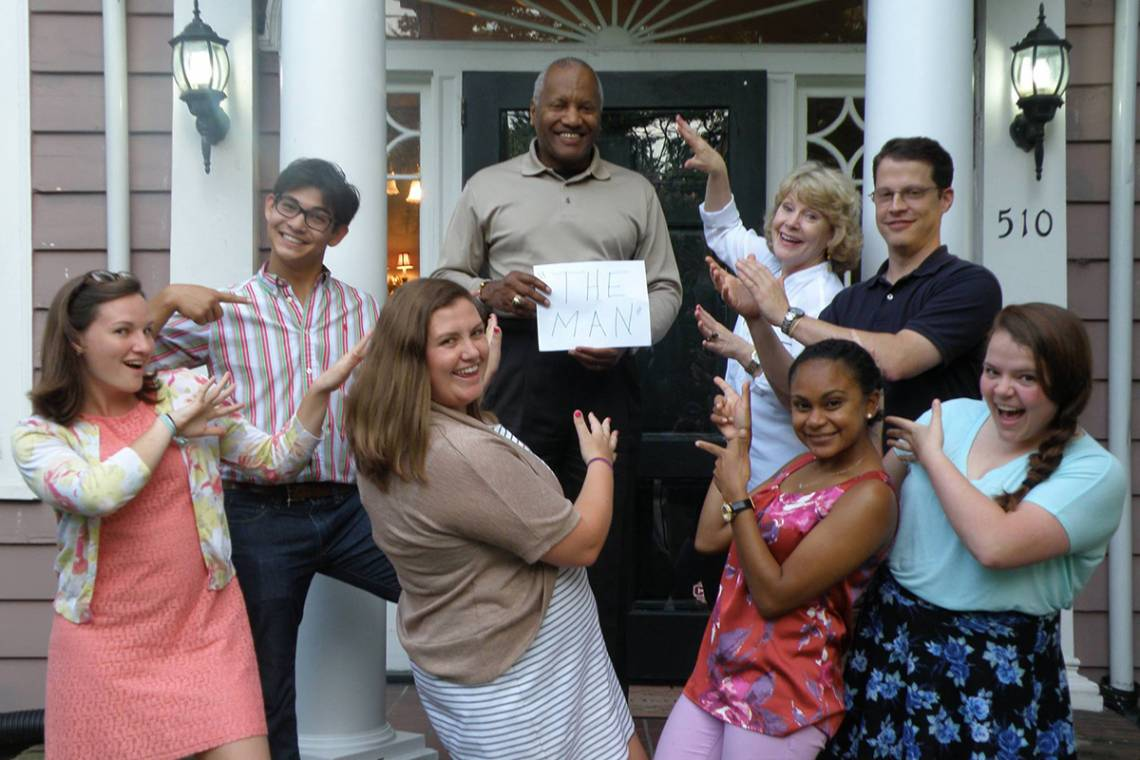 Phail Wynn celebrates with local public school teachers living in the Duke-sponsored Teach House.