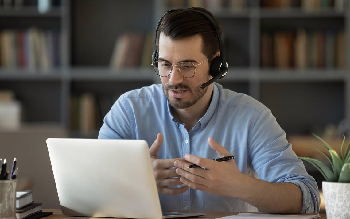 A man talks on his computer.