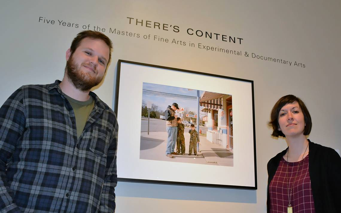 "Alex Cunningham and Lisa McCarty stand in the Rubenstein Photography Gallery, which will house the ""There's Content"" exhibit until June 20.  Cunningham curated the exhibit, which contains 23 photographs and six films celebrating the five-year anniversary"