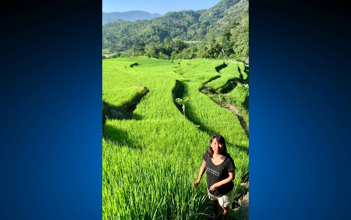 Trinidad Abe poses for a photo in front of rice paddies in Ifugao, a landlocked province in the northern neck of the Philippines. Photo courtesy of Trinidad Abe.