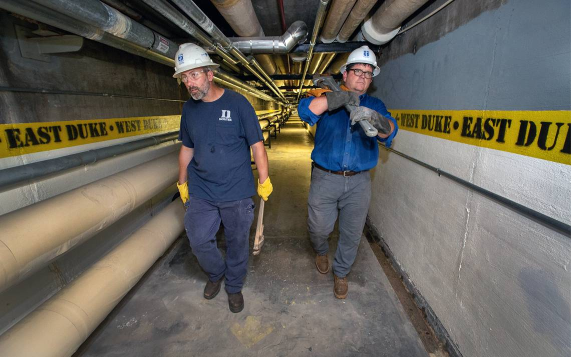 Tim Duggan, left, and Yancey Leonard, right, walk in the tunnel underneath East Campus. Photos by Chris Hildreth.