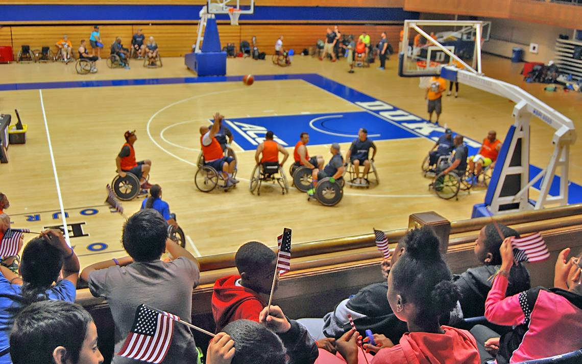 Students from Eastway Elementary School watch wheelchair basketball at Valor Games Southeast.
