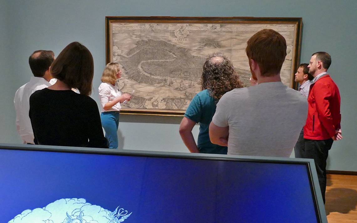 Kristin Huffman, center, discusses Jacopo de' Barbari's View, which depicts Venice around 1500.