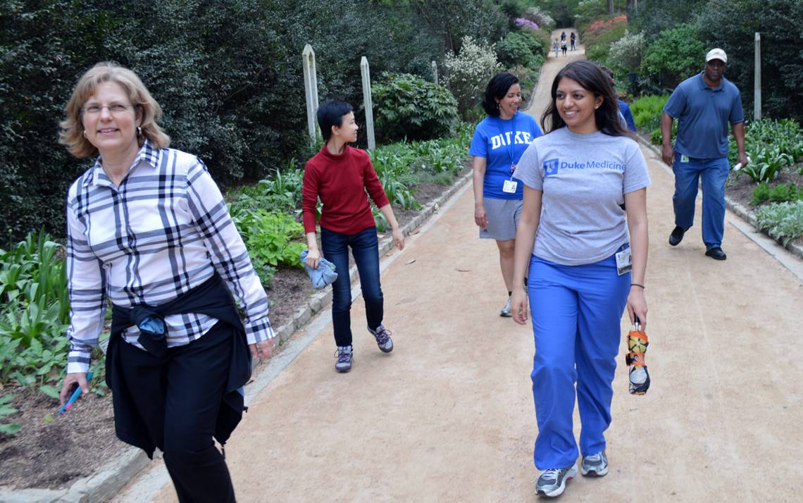 Dr. Preyanka Makadia, center, leads a group of Duke employees during