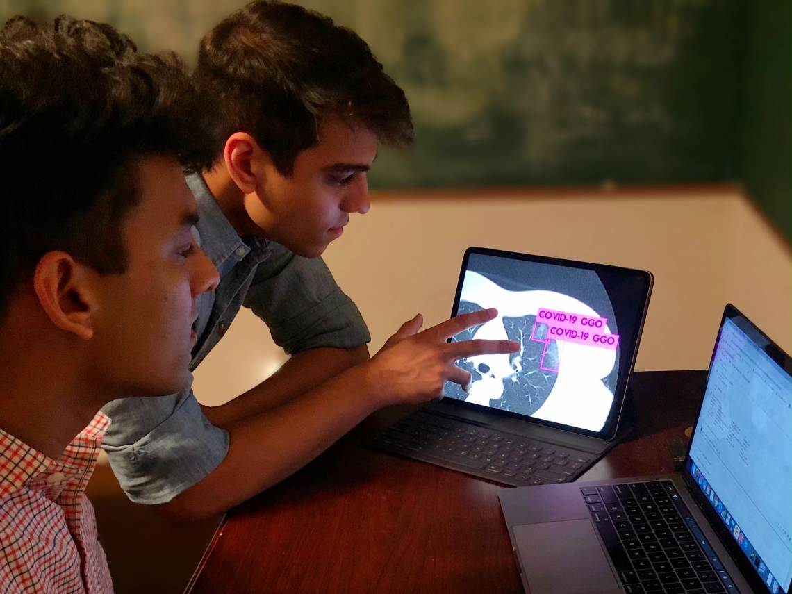 Duke students Anmol Warman '22 and Pranav Warman '20 have trained a computer to spot the telltale signs of COVID-19 in lung scans and rule out other infections that look similar to the human eye.