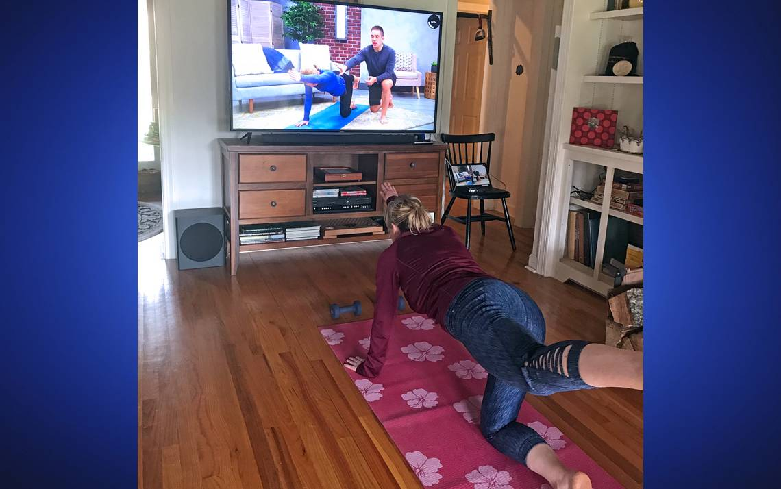 Beth Evans participates in a yoga class at home using Wellbeats. Photo courtesy of Beth Evans.