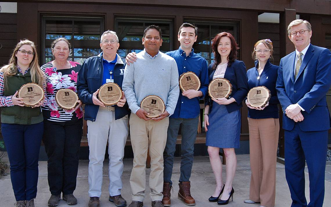 Duke Sustainability Award winners, from left to right, Belle Farish, Susan Jackson, Charlie Perez, Abhi Bathula, John Desan, Trisha Dupnock, Amanda Starling Gould and Duke University President Vincent E. Price. Photo by Stephen Schramm.