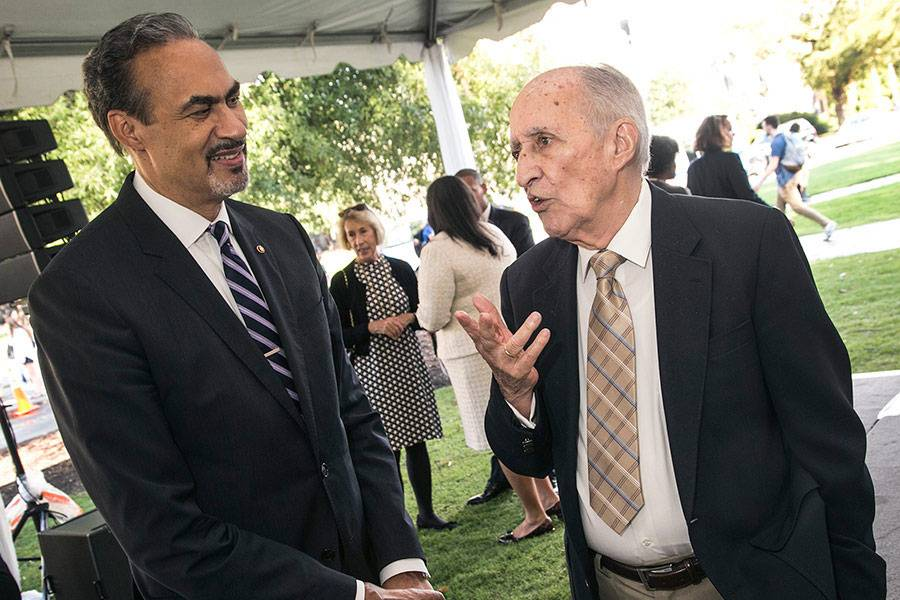 At a 2016 ceremony, Phil Freelon, left, talks with Julian Abele Jr., son of the architect who designed much of West Campus.