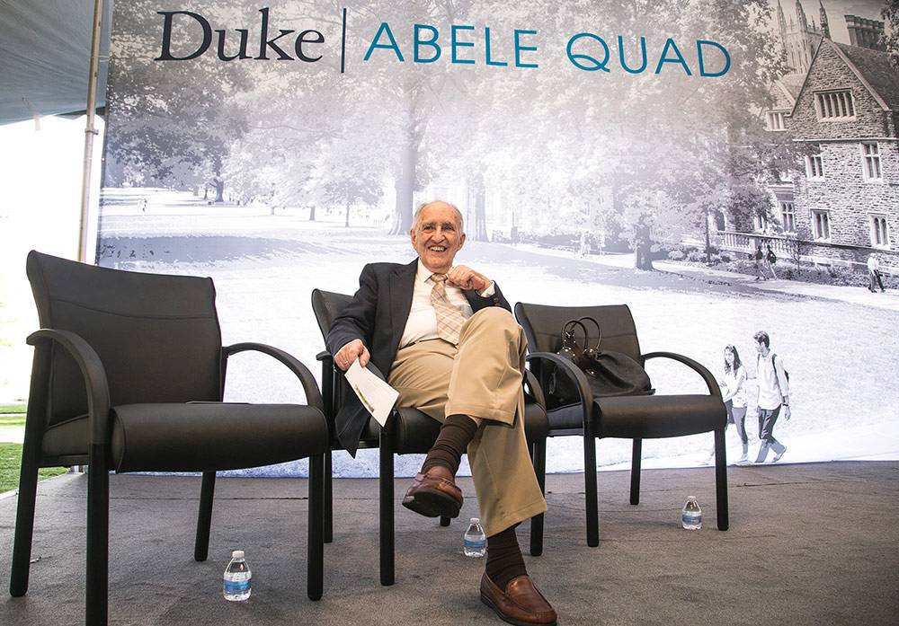 Julian Abele Jr. sits on the dais before Friday's ceremony dedicating a West Campus quad after his father. Photo by Chris Hildreth/Duke Photography