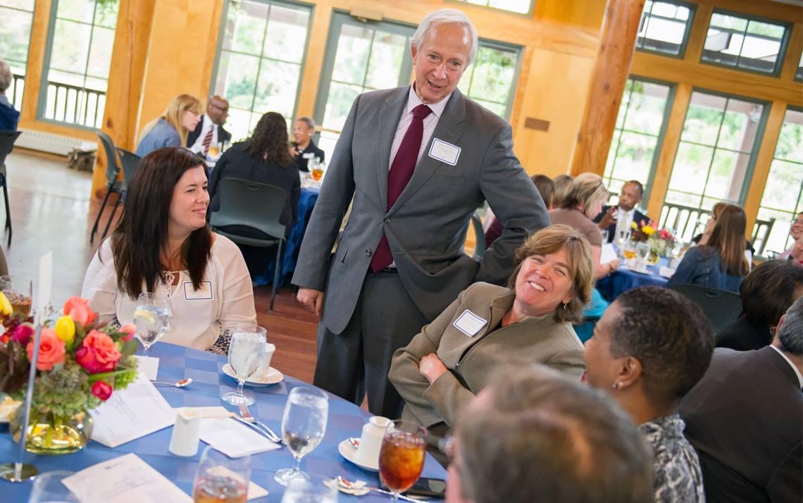 Duke President Richard H. Brodhead talks with Teamwork and Diversity Award recipients at a luncheon held Nov. 1 in Sarah P. Duke Gardens' Doris Duke Center.