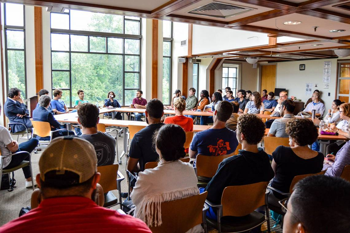 Students and faculty, all from Brazill, discuss that country's unusual and important presidential election. Photo by Joel Luther
