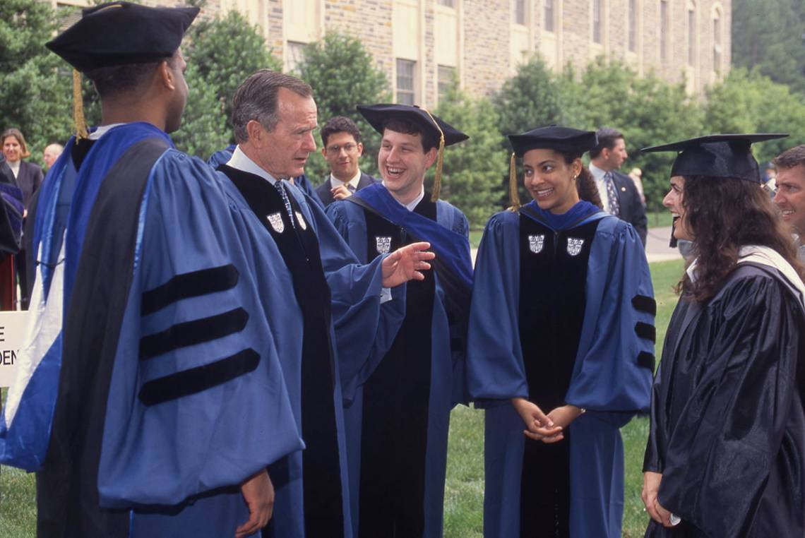 George H.W. Bush talks with students following the 1998 commencement ceremony. Photo courtesy University Archives.