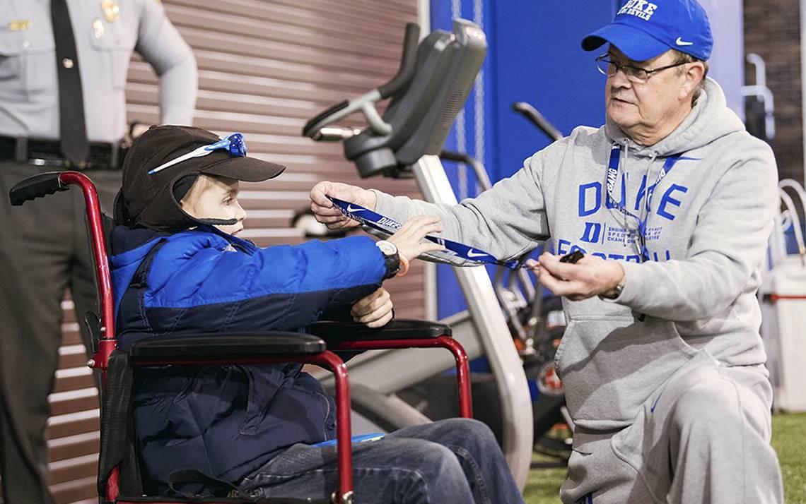 Howell Brown III, 13, and Duke Football Coach David Cutcliffe.