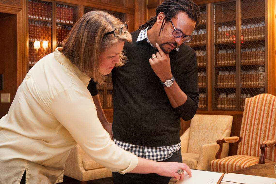 Colson Whitehead studies a Langston Hughes text in the Rubenstein Library.