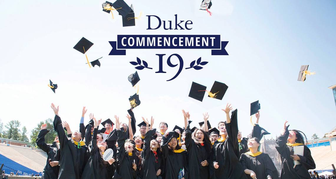 Duke students toss their mortarboards in the air in celebration of commencement
