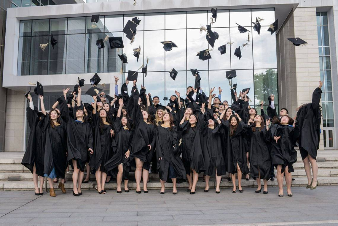 Duke Kunshan University MMS graduates celebrate following the awarding of degrees.