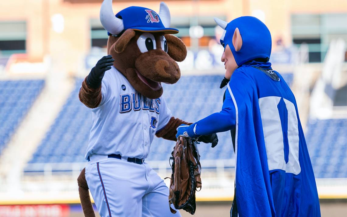 Durham Bulls mascot Wool E. Bull greets the Duke Blue Devil during the two teams' 2017 meeting. Photo courtesy of Duke Athletics.