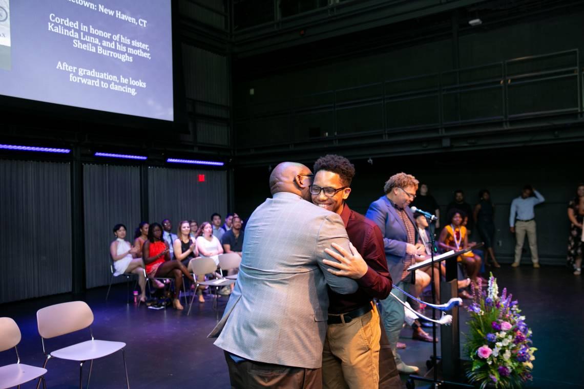John Blackshear, assist. vice provost for undergraduate education, hugs Kalito Luna, a public policy major from Connecticut, during the Duke LIFE cording graduation  ceremony.