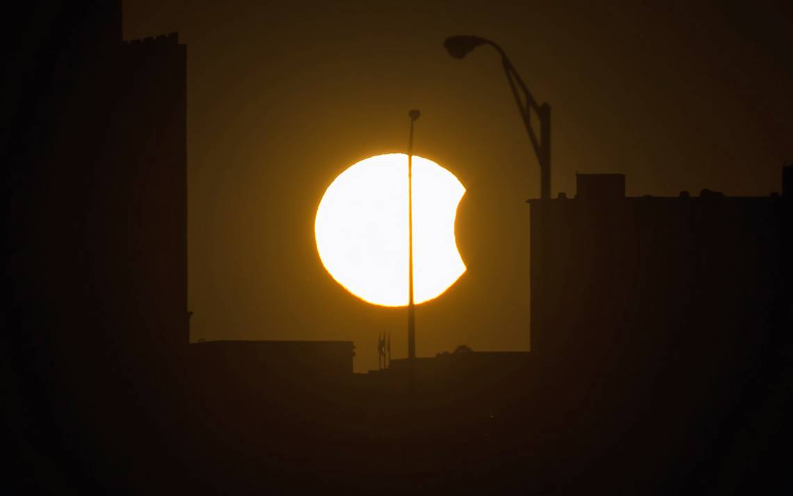 A partial solar eclipse is visible just before sunset Thursday, Oct. 23, 2014, in Arlington, VA. Photo by Bill Ingalls/NASA.