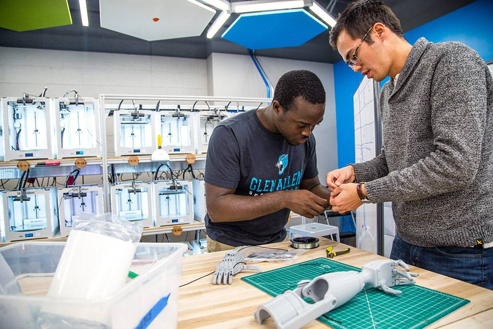 Duke seniors Richard Beckett-Ansa and Henry Warder co-founded the eNABLE chapter, which makes prosthetics using 3D printers. Photo by Pilar Timpane