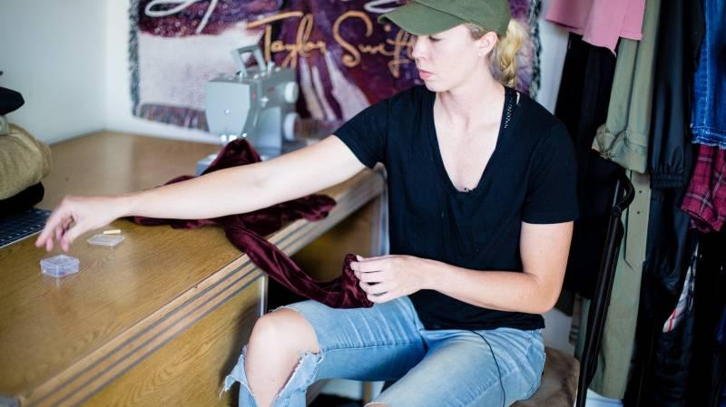 Erin Mathias plans fashions at her work desk. Photo by Pilar Timpane