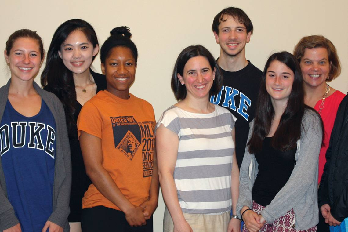 Anna Gassman-Pines, shown with students in the Bass Connections' Education and Human Development theme.
