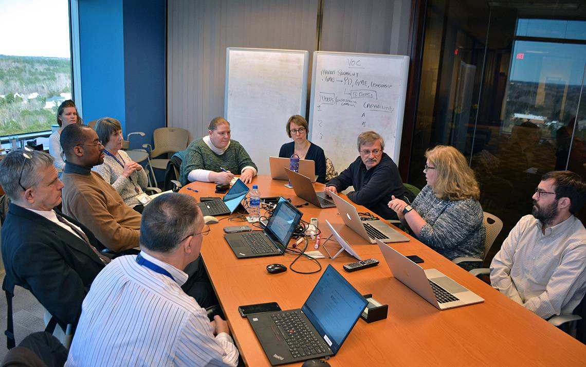 Members of the TechExpo planning committee meet to discuss this year's event. Photo by Jonathan Black.