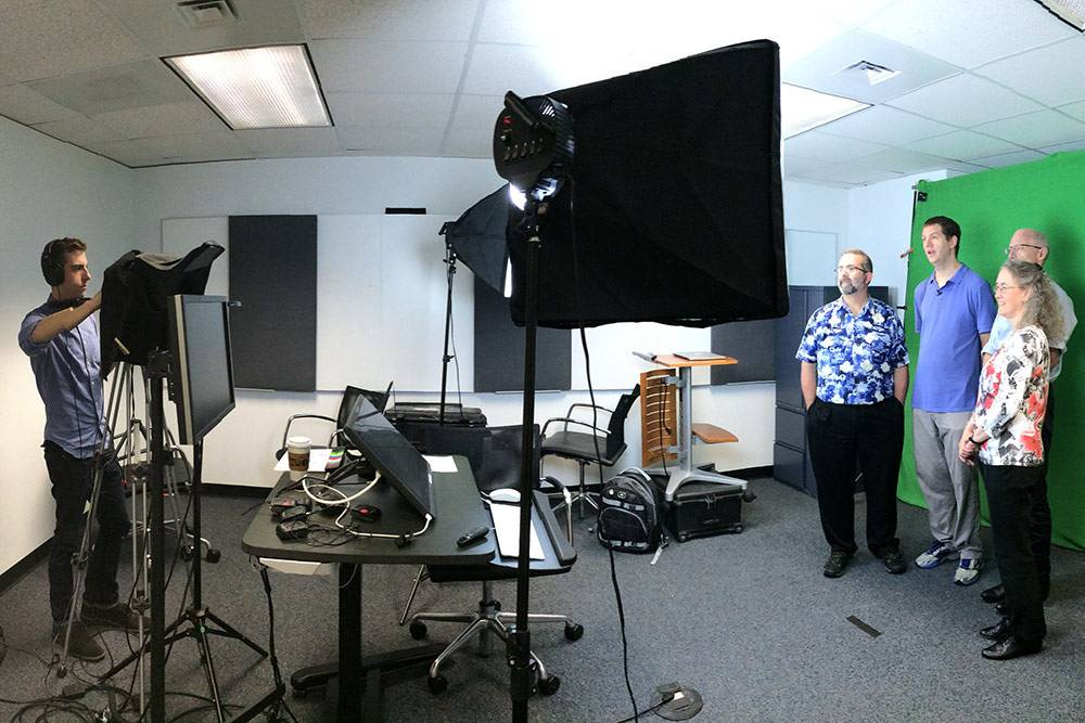 Duke faculty prepare for a shooting of an online learning course on Java.