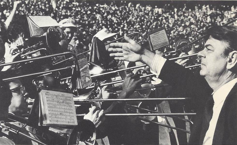 Jim Henry directs the pep band.
