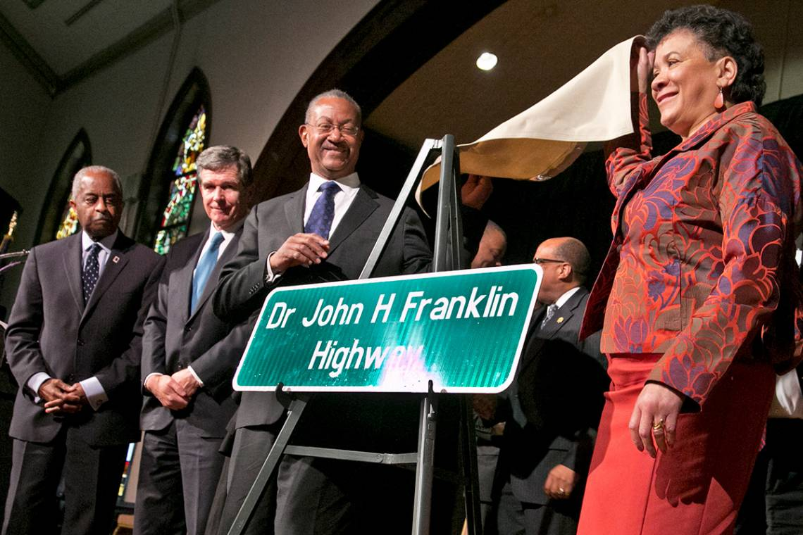 Professor Franklin's son John W. Franklin and his wife, Karen Roberts Franklin unveil the dedication sign as Gov. Roy Cooper and Durham Mayor William Bell watch. Photo by Chris Hildreth/Duke Photography