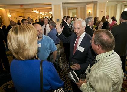 Duke University President Richard H. Brodhead, center, talks with award recipients at the Presidential Awards luncheon Thursday. Photo by Duke Photography