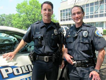 Duke University Police Department Officers Andrew Corolla, left, and Ryan LaDuke, right, responded to Alumni Affairs. LaDuke captured the bat. Photo by Leanora Minai.